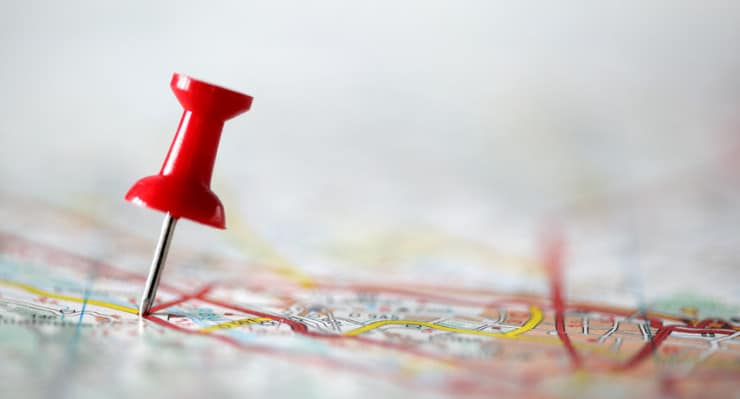 Red pushpin showing the location of a destination point on a map